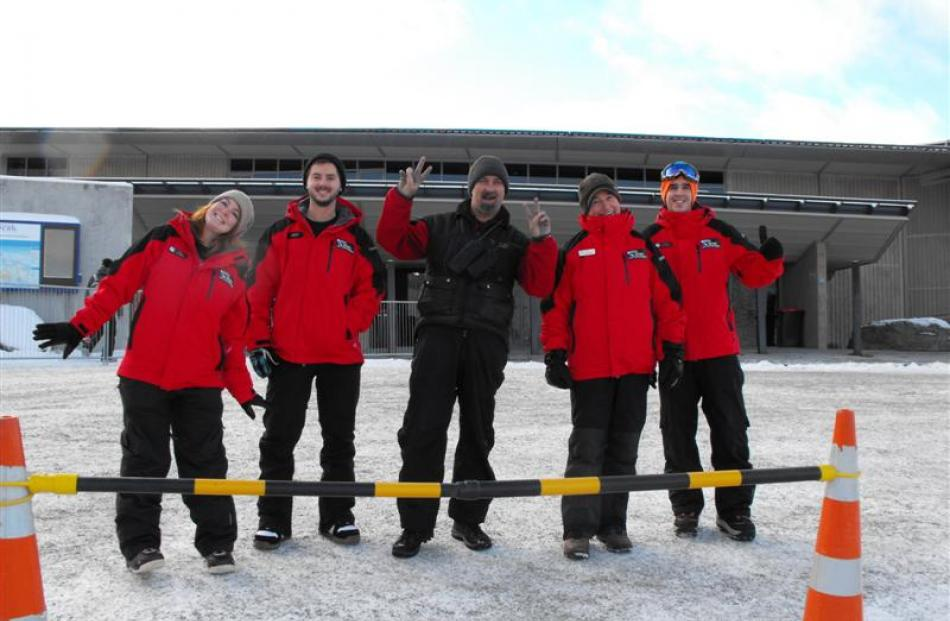 Coronet Peak workers were up on the mountain early to help the many patrons with directions. They...
