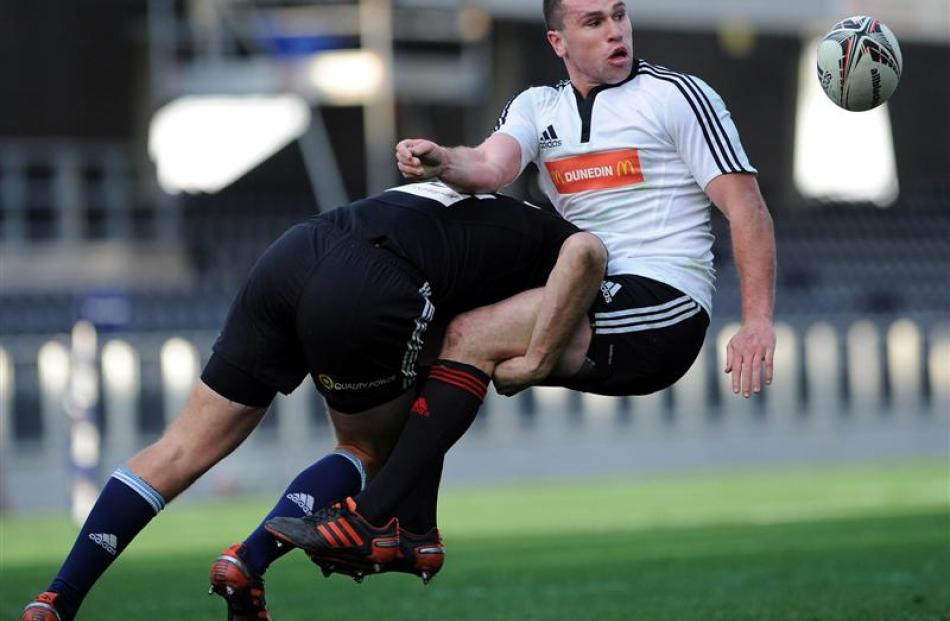North Island second five-eighth Hadleigh Parkes tackles Marshall.