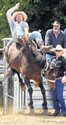 Hugh Graham, of Fairlie, wins the 2nd division bareback riding contest at the Lawrence Rodeo....