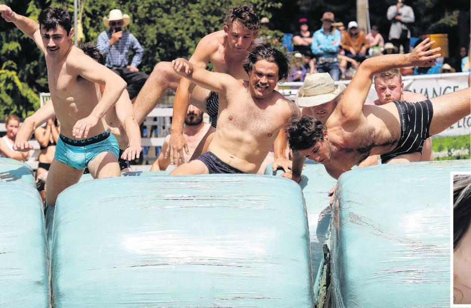 Competitors in the men's undie race at the Lawrence Rodeo head over the first obstacles.