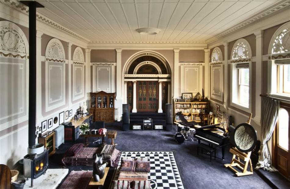 The original synagogue is now a living space. The black and white squares are a Masonic...