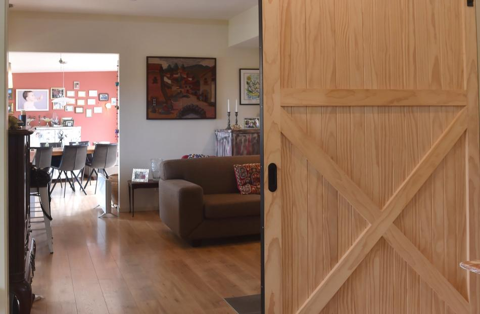 With the barn door in the hall open, it is possible to see from one end of the house to the other.