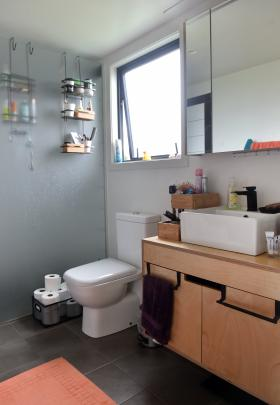 The bathroom vanity, made of treated ply, was designed by architect Maria Callau.