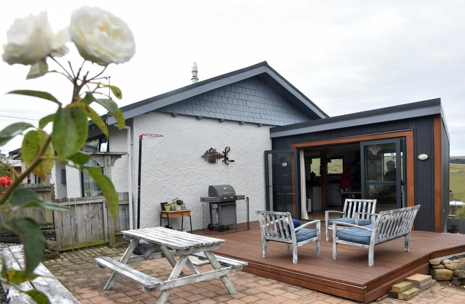 The house was extended towards the west to connect to the patio. The angled external wall makes...