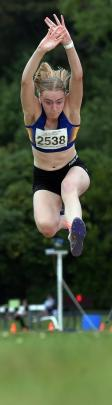 Isabella Henderson (17) gets plenty of air competing in the long jump.
