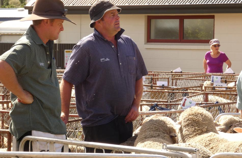 Lochie Rutherford (left), of Poolburn, and Andrew Paterson, of Matakanui Station, wait to find...