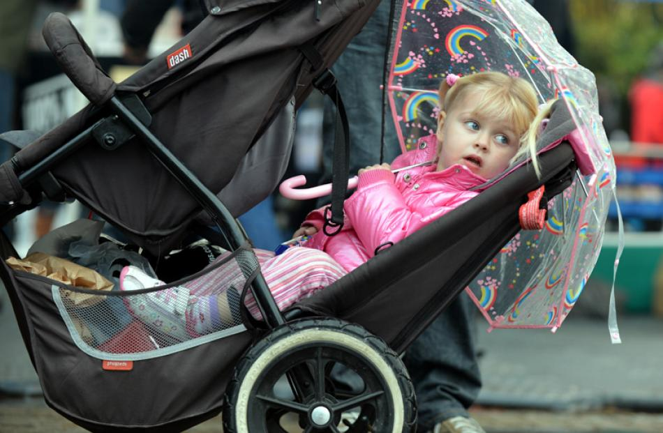 Keeping dry: Brianna Andrews (3) of Queenstown.