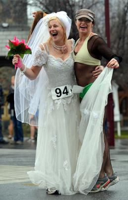 Preparing for the Golden mile run Julia Blanchard (as a bride, left) and Donna Fallon, both of...
