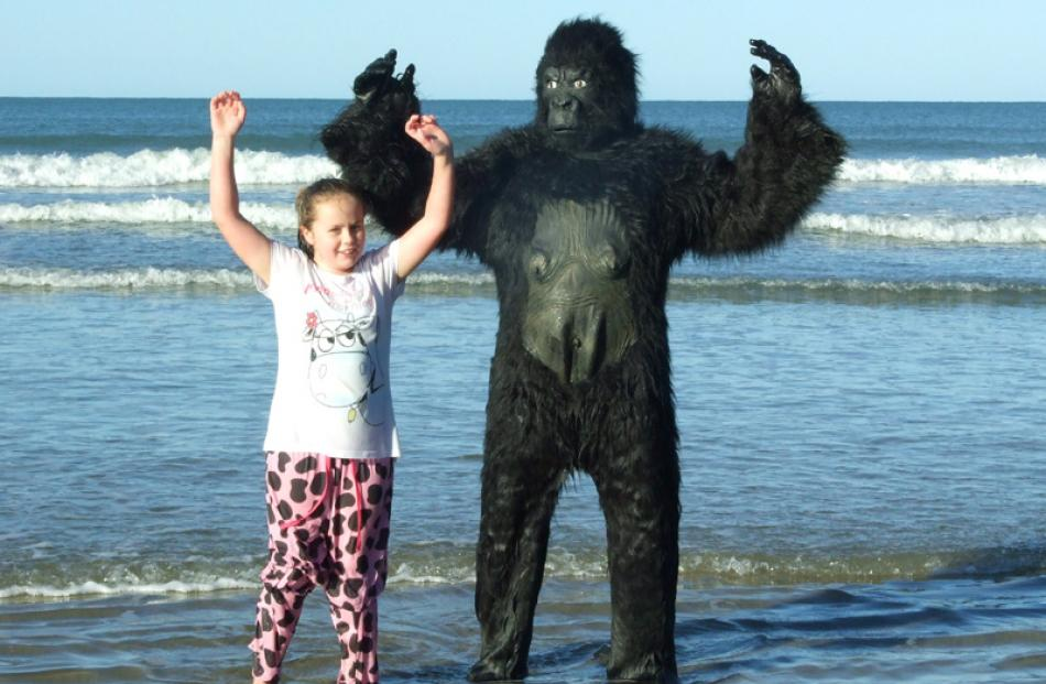Maddie Deacon (8) and her pet gorilla Mark.