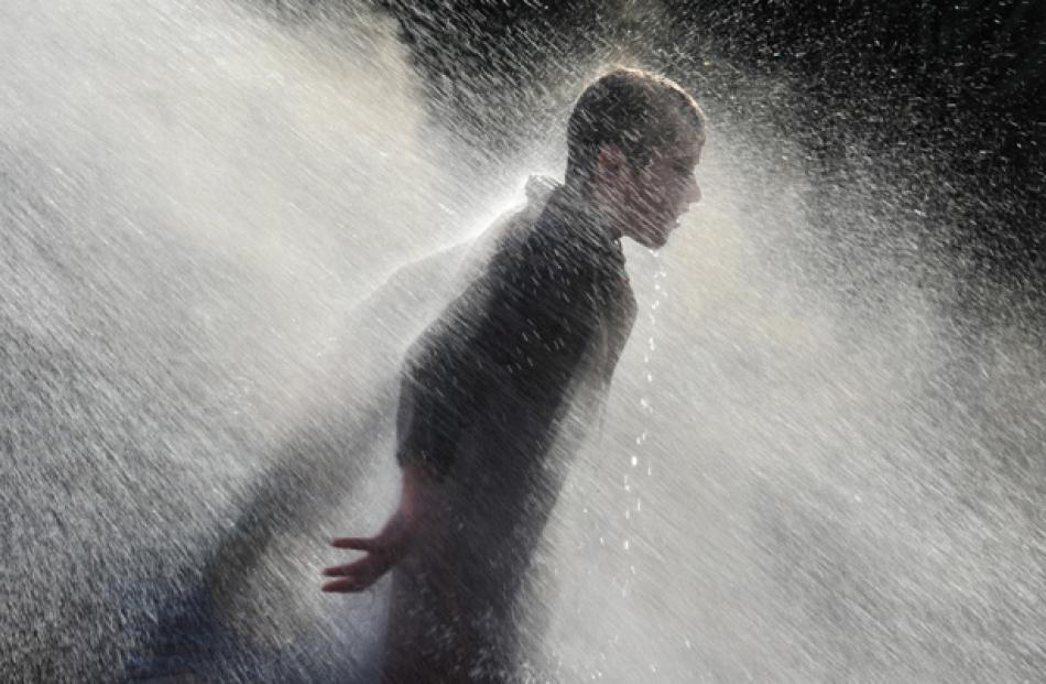 Harrison Campbell (12) enjoys a warm shower.