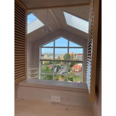 The bedroom in the larger unit is at the back of the property but connects to the view at the...
