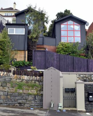 These two tiny houses were squeezed on to a steep section in central Dunedin. One has a separate...