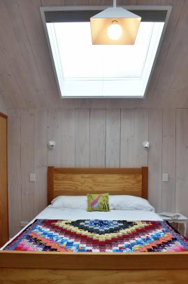 Skylights, angled to maintain privacy, flood the interiors with natural light.