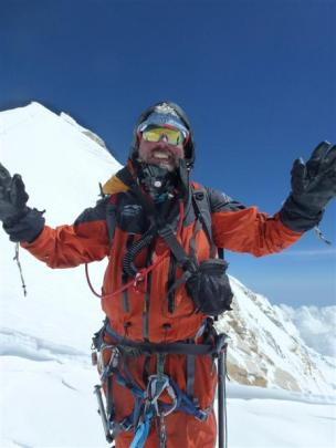 Guy Cotter celebrates his team reaching their goal near the summit of Manaslu. Photo supplied.
