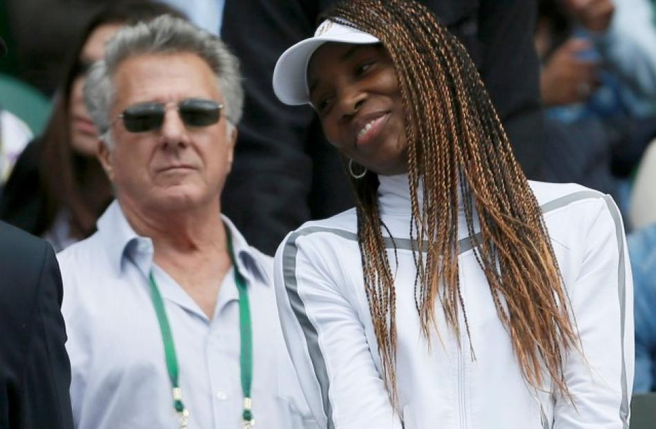 Actor Dustin Hoffman (L) stands on Centre Court with Venus Williams for the women's singles match...