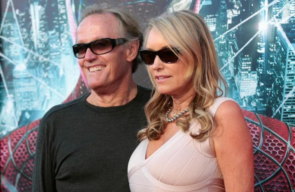 Actor Peter Fonda and his wife Margaret DeVogelaere pose at the premiere of 'The Amazing Spider...