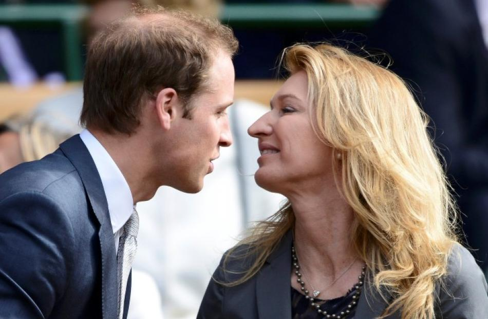 Britain's Prince William (L) greets former tennis player Steffi Graf on Centre Court for the men...