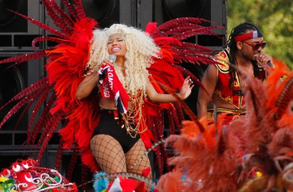 Trinidad-born hip hop artist Nicki Minaj (L), performs alongside soca artist Machel Montano...
