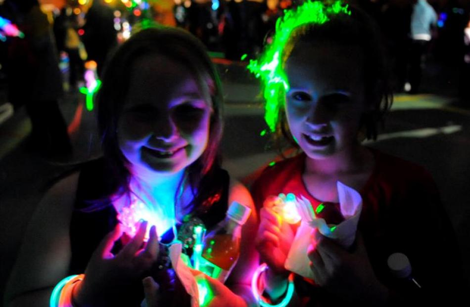 Amber Dovey (9, left) and Emma Bower (8) light up the Blue Light Cadbury Disco at the Dunedin...