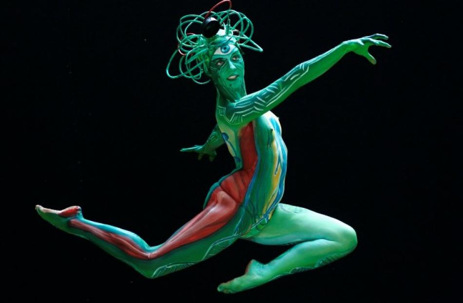 A model jumps as she poses during the annual World Bodypainting Festival in Poertschach, Austria....