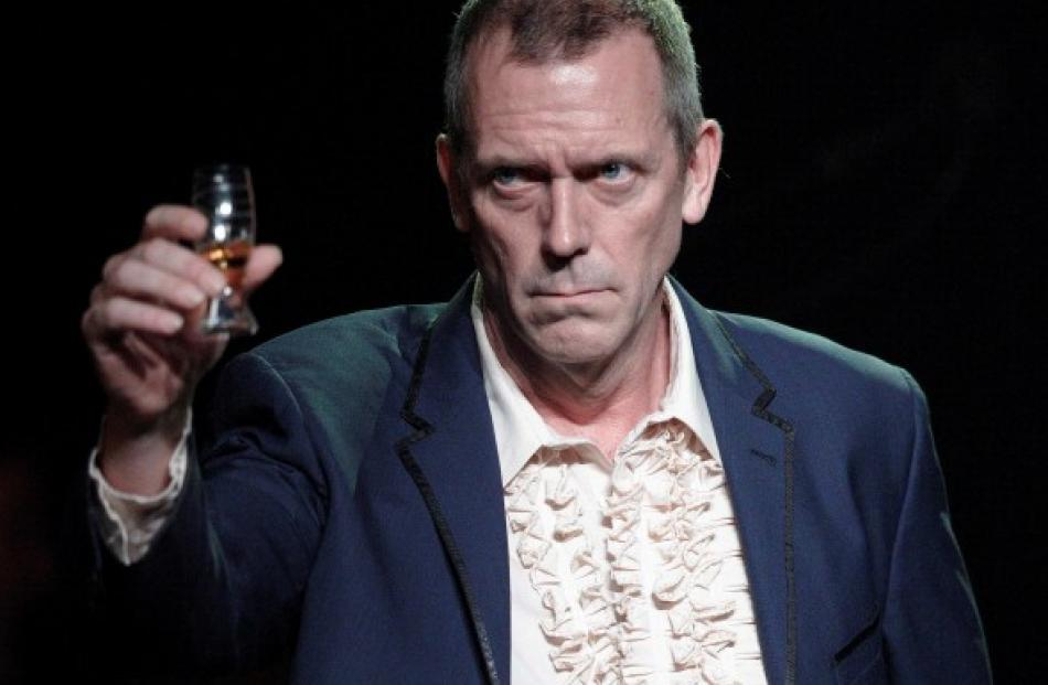 British singer and actor Hugh Laurie greets the audience before his performance at the 46th...
