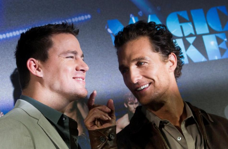 Cast members Channing Tatum (L) and Matthew McConaughey pose for pictures during a photocall...