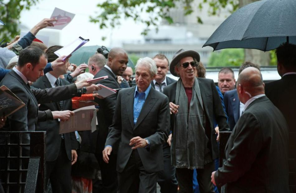 Rolling Stones Charlie Watts and Keith Richards (centre L and R) arrive for the opening of the...