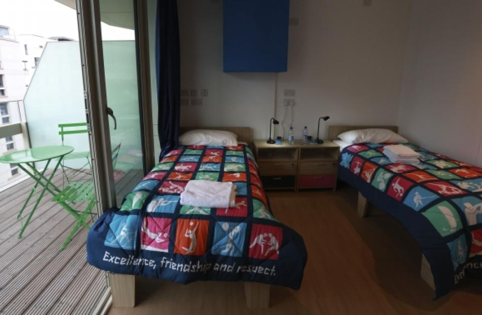 A twin bedroom and balcony in the Olympic Village. Photo by Reuters.