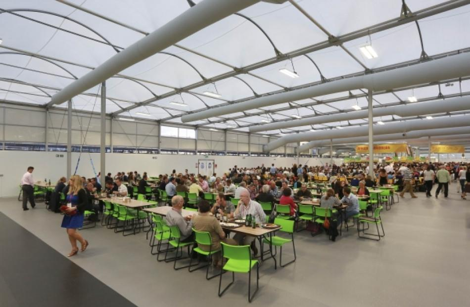 Guests test the 5,000 capacity Olympic Village dining room. Photo by Reuters.