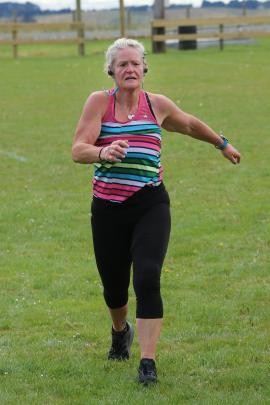 The winner of the 11km walking race, Karla Gilder, of Kaka Point, completes her race in a strong...