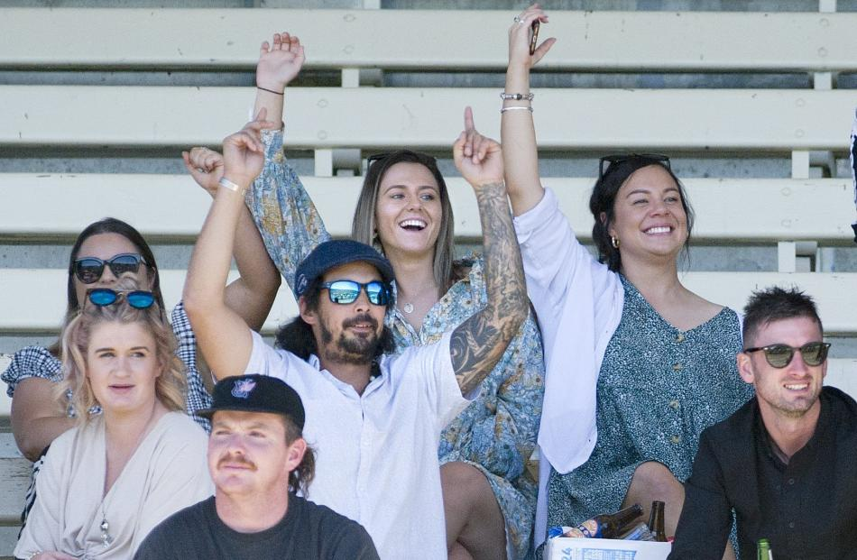 The crowd was in good spirits at the Wingatui Racecourse yesterday.