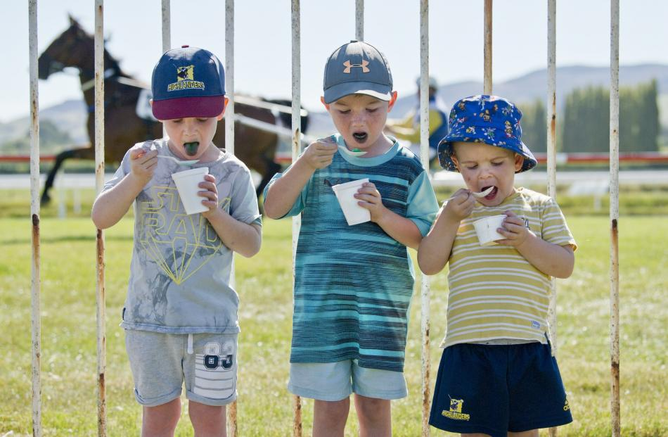 Enjoying a frozen treat while watching the horses are (from left) Billy Simpson (5), Lachie...