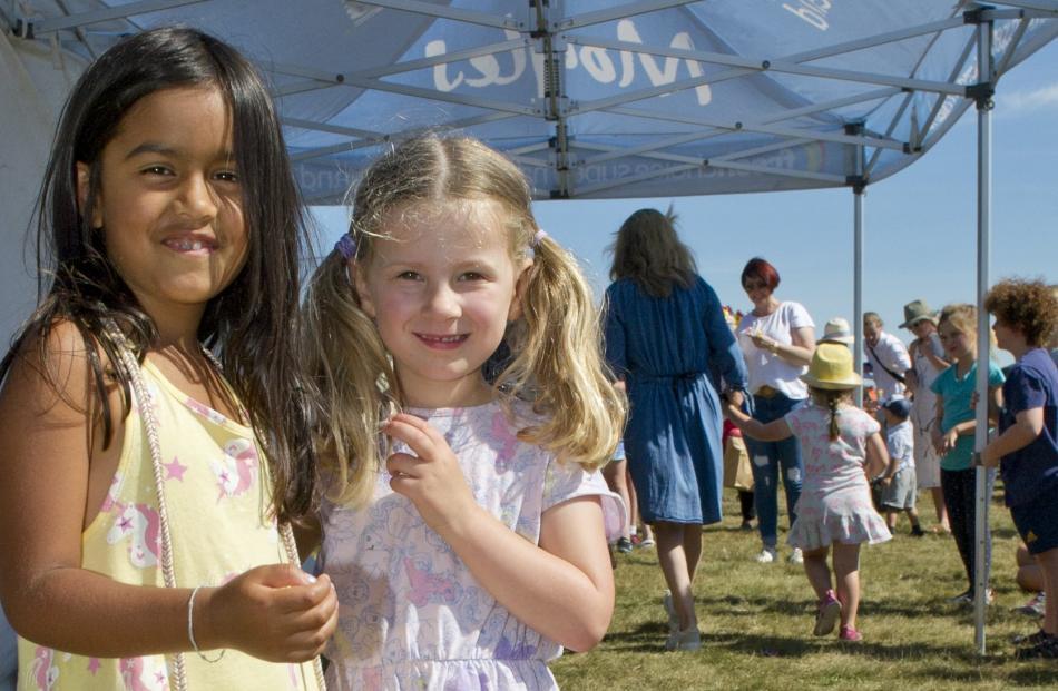 Proud participants in the Wingatui Racecourse children's fashion show Bella Walker (5, left) and...