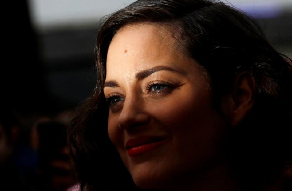 French actress Marion Cotillard arrives at the European premiere of 'The Dark Knight Rises' in...