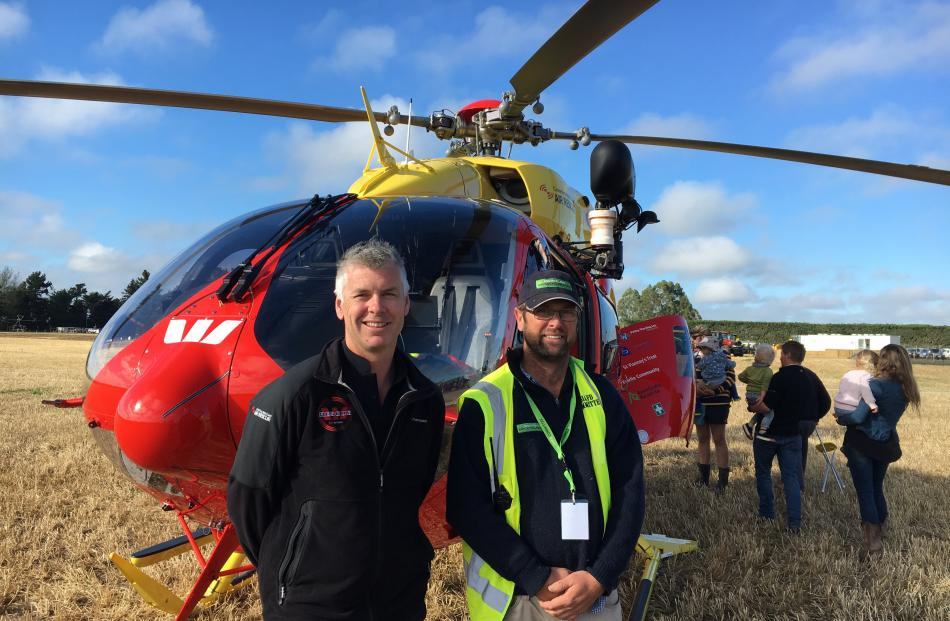 Westpac Rescue Helicopter intensive care paramedic Shane Lynch (left) chats to South Island...