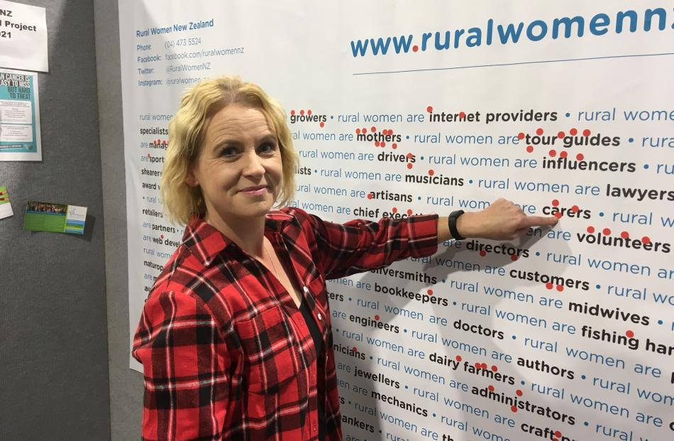 Donna Smith, of Christchurch, points to her occupation. Rural Women New Zealand put up the wall...