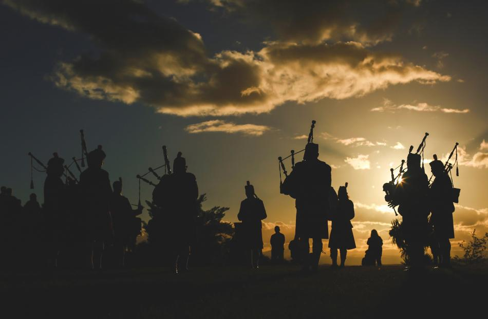 The North Otago Highland Pipe Band performs at Lookout Point in Oamaru at sunset on Good Friday. PHOTO: REBECCA RYAN