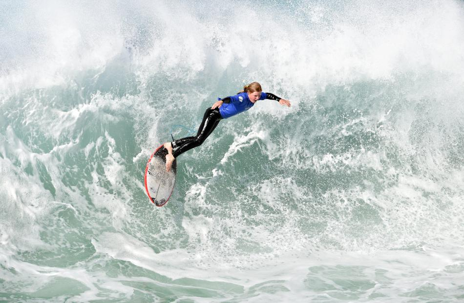 Poppie Entwisle, of Christchurch, catches a wave in the under-14 girls division final.