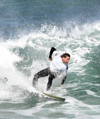 Reuben Woods, of Mount Maunganui, rides a wave during the men's open division final.