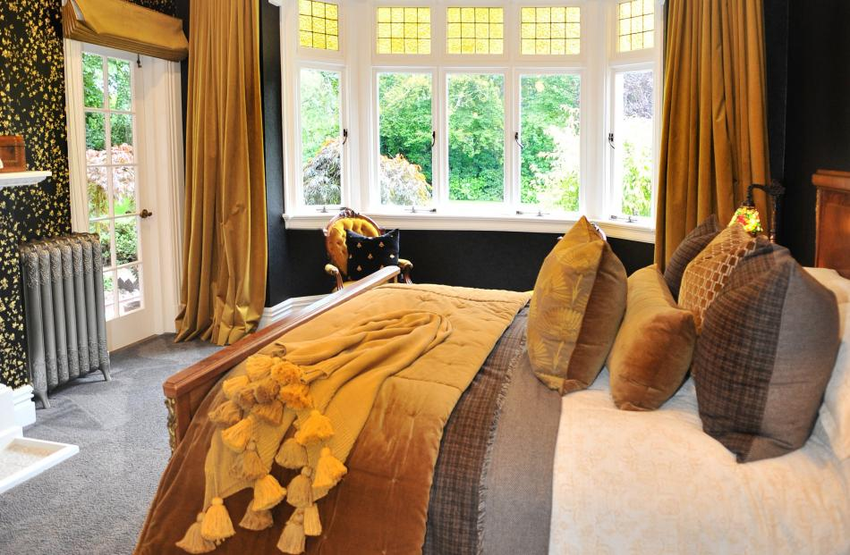 Almost every room has a view of the grounds and the English trees planted by the original owner.