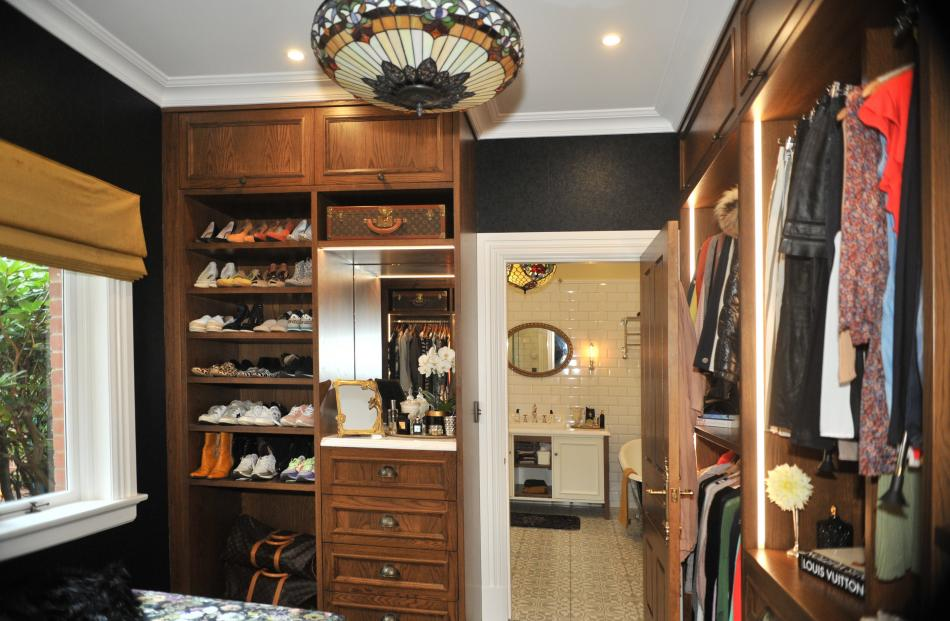 Under-used rooms on the ground floor were combined to form a master bedroom, dressing room and en...