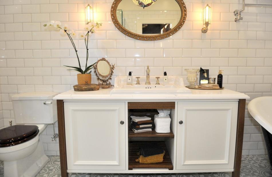 The en suite looks traditional but modern comforts such as underfloor heating and step lighting...