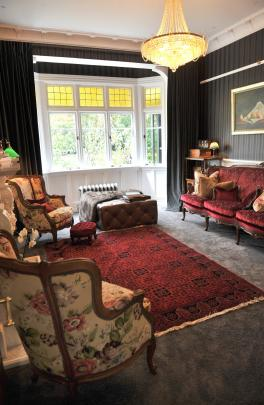The original dining room is now a small lounge. Much of the antique furniture in the house has...