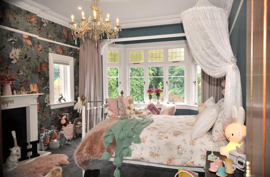 Harper's bedroom is one of four rooms where the owners replaced fire surrounds that had been...