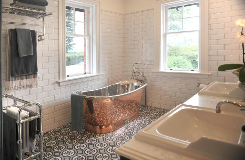 The copper and nickel bath came with white gloves, to be worn by those lifting it out of its...