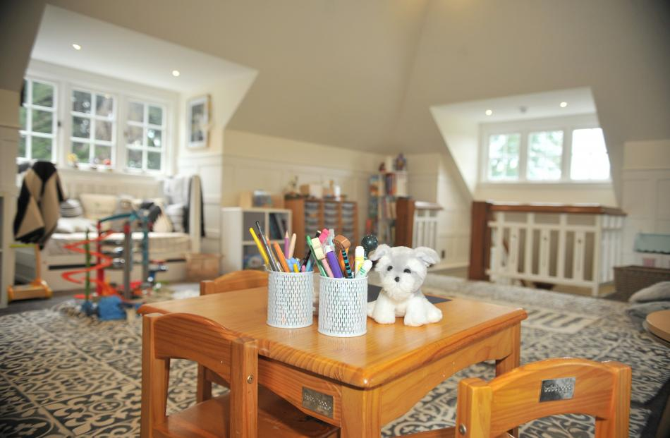 When previous owners had the house, the attic playroom was a billiards room with dark woodwork.