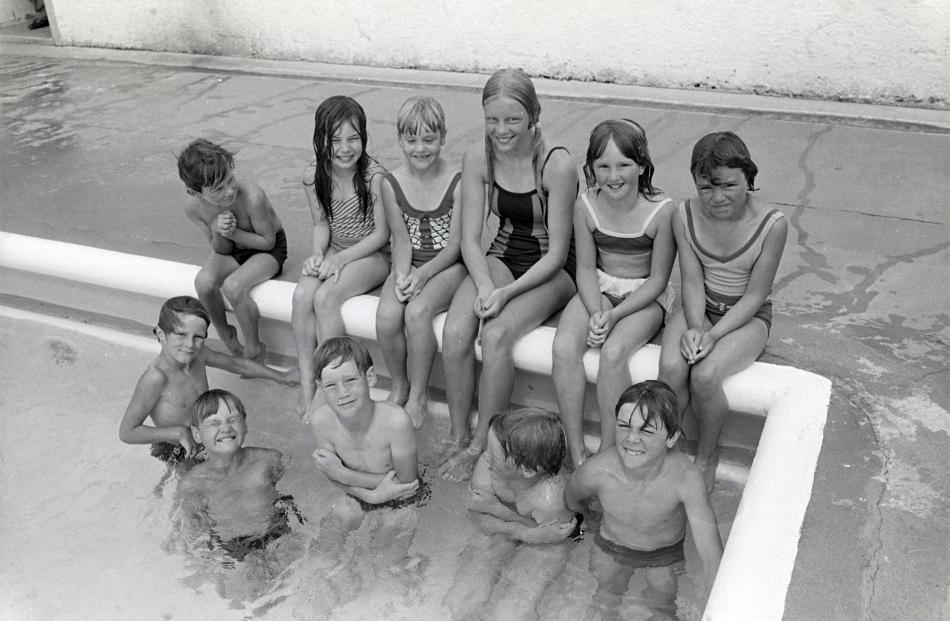Children braved the elements at an uncovered Mosgiel pool for decades before a roof was added....
