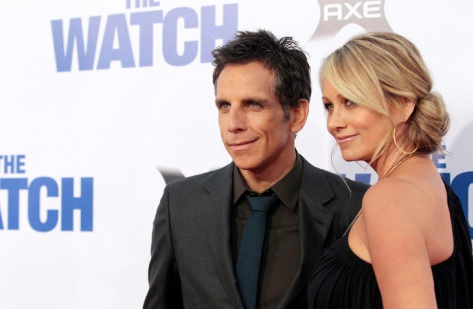 Cast member Ben Stiller and his wife Christine Taylor pose at the premiere of 'The Watch' at the...