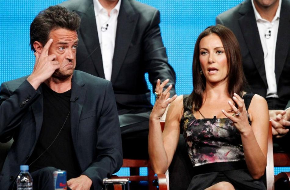 Cast members Matthew Perry and Laura Benanti attend a panel for 'Go On' in Beverly Hills. REUTERS...
