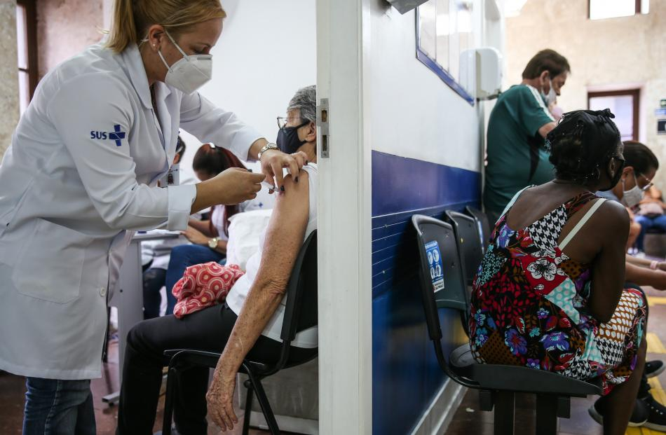 A senior citizen receives the Covid-19 shot in Sao Paulo, Brazil. Less than 4% of the country's...